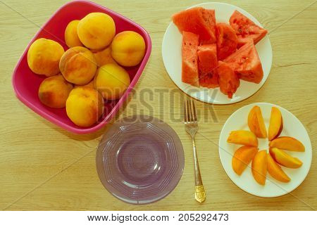 Beautiful sweet peaches and slices of watermelon. Ripe fruit on the table - Retro color