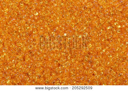 Close up of bright orange seed beads. High resolution photo.