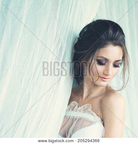Beautiful Woman with Makeup and Hairstyle Fashion Portrait