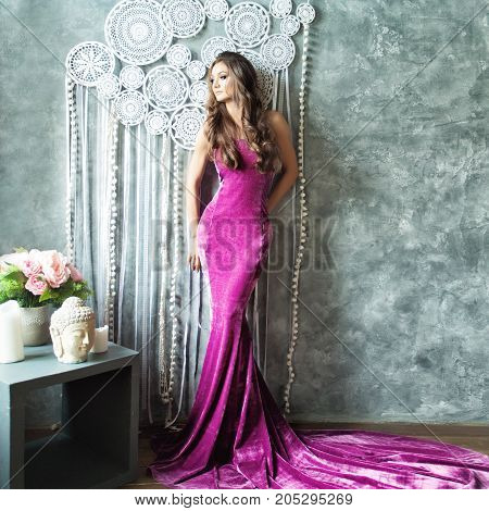 Glamorous Woman in Fashionable violet Dress Posing