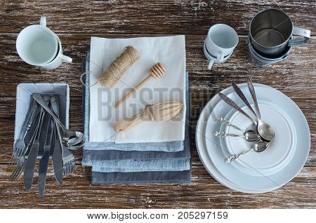 Kitchen Tools and helpers food photography accessories background. Ceramic cups silver spoons linen napkins wooden utensils cookware. All you need for cook and make photo.