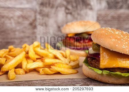 Snack of Delicious tasty burgers on wooden background. Fast and tasty food