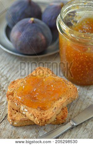 Fig Jam and crispy rusk on wooden background