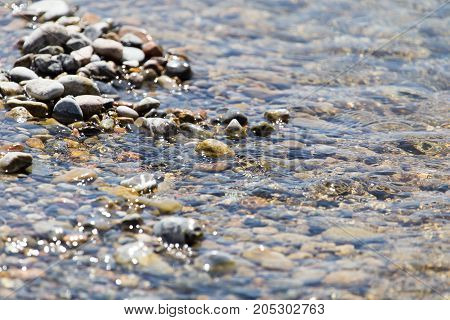 Stones in water Nature . In a park in the nature