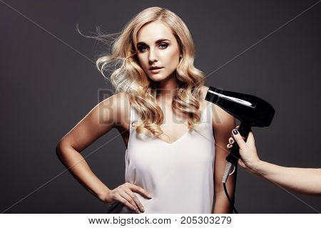 Elegant Blond Woman In A Studio