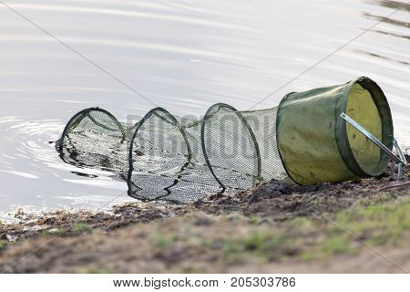 fish in cages . In a park in the nature