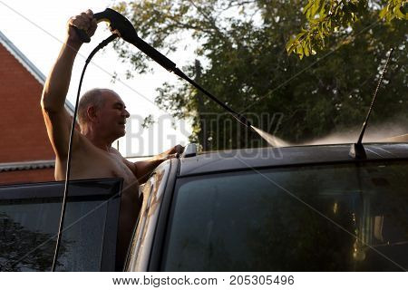 Senior Man Washing Car