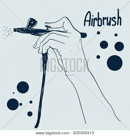 Hand holding a professional airbrush. can be used as logo.