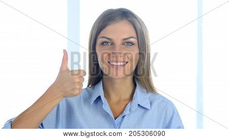 Portrait Of Positive Young Woman Gesturing Thumbs Up