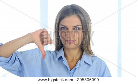 Portrait Of Upset Young Woman Gesturing Thumbs Down