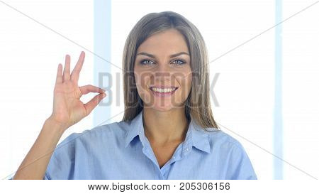 Portrait Of Satisfied Young Woman Gesturing  Okay Sign