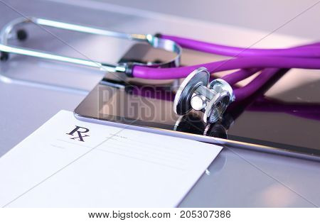 medical stethoscope with a computer on the desk.