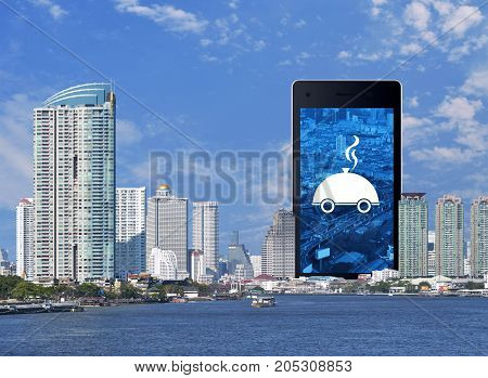 Restaurant cloche flat icon on modern smart phone screen with modern office city tower river and blue sky Food delivery concept