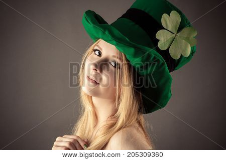 portrait beautiful girl in image of leprechaun on St. Patrick's Day