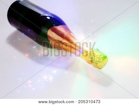 Lying new champagne bottle isolated on the table