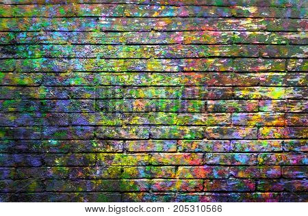 Brick wall painted with spots of paint colors