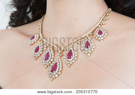 Close up of pink and white diamond necklace