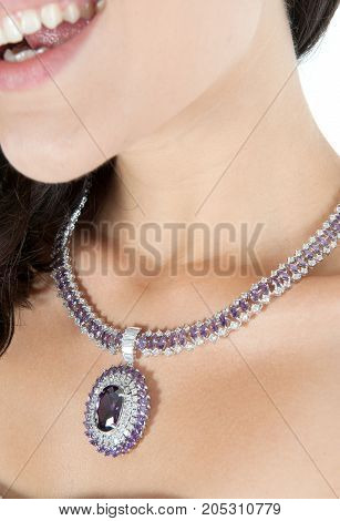 close up of beautiful woman's necklace in studio