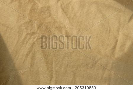 close up of brown cotton fabric texture and background