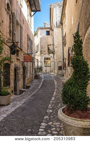 SAINT-PAUL-DE-VENCE FRANCE - APRIL 25 2016: Street of Saint-Paul-de-Vence one of the oldest medieval towns on the French Riviera well known for its contemporary art museums and galleries France