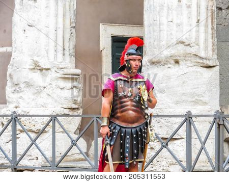 ROME, ITALY - SEPTEMBER 1, 2013: Street actor representing the Roman soldier