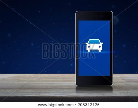 Taxi car flat icon on modern smart phone screen on wooden table over fantasy night sky and moon Internet business service transportation concept