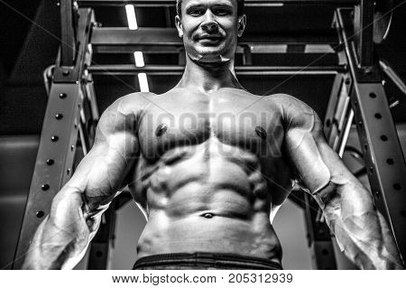 Handsome Model Young Man Training Abs In Gym