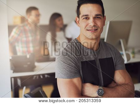 Young Businessman With Arms Crossed In Office