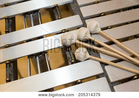 xylophone, music and chromatic instrument concept - closeup on wooden bars with four mallets, glockenspiel, marimba, balafon, semantron, pixiphone, education and orchestra concert usage, top view