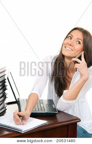 Business Woman At Work Place Table Talking On The Phone