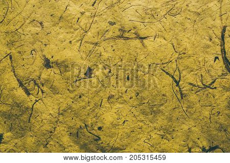 Abstract yellow texture and background for designers. Vintage paper background. Rough yellow texture made with recycled paper. Closeup view of abstract yellow texture. Vintage yellow paper.