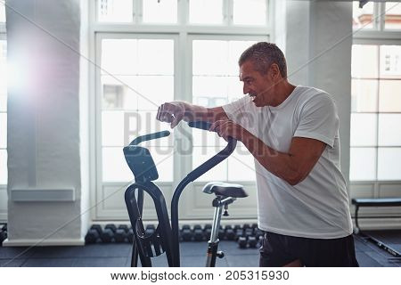 Mature Man Resting After A Stationary Bike Workout