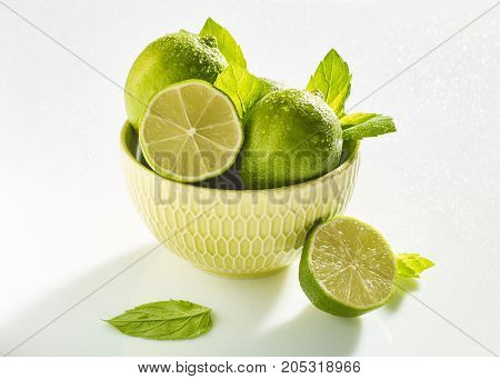 Organic limes on wooden table. Lime fruits