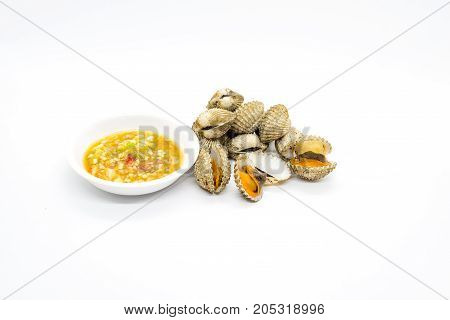 Cockle with dipping sauce on white background