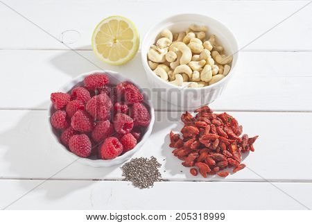 Sweet dessert ripe raspberry on bowl isolated  background