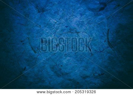 Abstract blue texture and background for designers. Vintage paper background. Rough blue texture of recycled paper. Closeup view of abstract blue texture. Vintage blue paper.