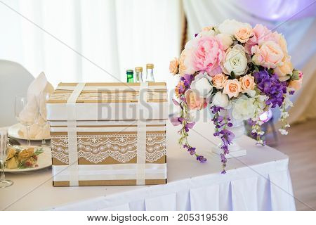 present woth flowers on the table in bright hall