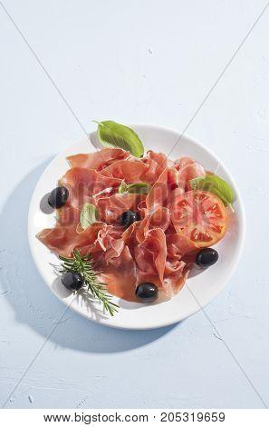 spanish serrano ham on a slate tray