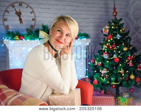 Beautiful young woman on the background of a New Year's background. Christmas night
