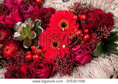 A Bouquet Of Flowers On A Grey Background