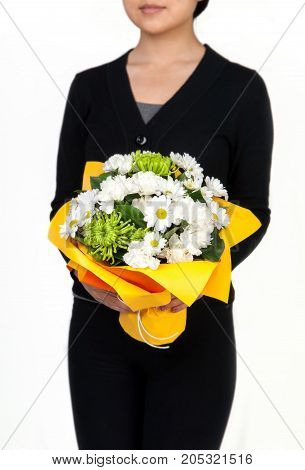 Woman Holds Flowers In Hands