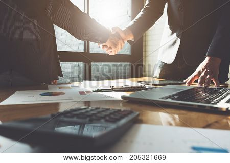 Business partnership meeting concept. Image businessmans handshake. Successful businessmen handshaking after good deal. Group support concept.
