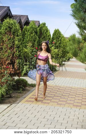 Beautiful View On The Green Trees Alley And Happy Young Girl Posing On Camera. Amazing Park In Summe