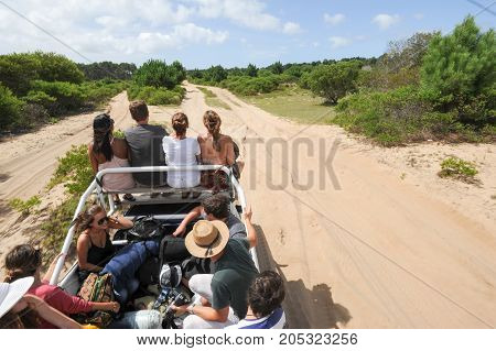 People Traveling On A Truck To Reach Cabo Polonio