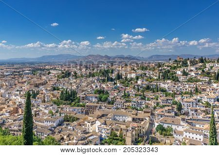 Panoramic view over Granada with the old town, the Arabian quarter Albaicin and the mountains In the background