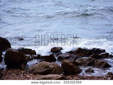 Wave and rock on the coastline in holiday