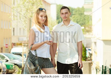 Love romantic walks concept. Man and blonde woman walking in city on sunny day enjoying romance happy being together.