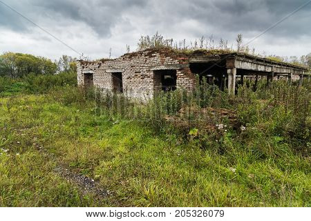 The old destroyed cowshed of the Soviet period in Russia