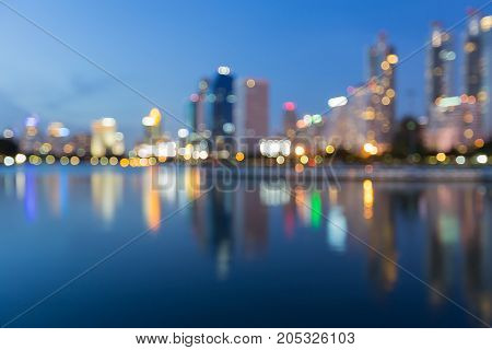 Reflection office building water front at twilight abstract background