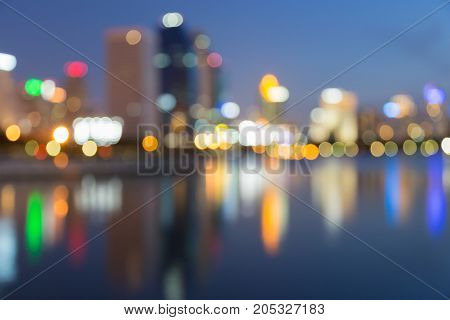 Twilight blurred bokeh city office building and reflection abstract background